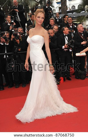 "Cannes Jury member Uma Thurman at the gala premiere for ""Midnight in Paris"" the opening film at the 64th Festival de Cannes. May 11, 2011  Cannes, France Picture: Paul Smith / Featureflash - stock photo"