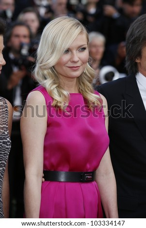CANNES - MAY 23: Kirsten Dunst at the premiere screening of 'On the Road' presented in competition at the 65th Cannes film festival on May 23, 2012 in Cannes - stock photo