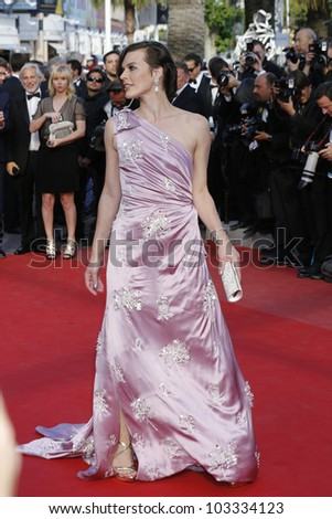 CANNES - MAY 23: Milla Jovovich at the premiere screening of 'On the Road' presented in competition at the 65th Cannes film festival on May 23, 2012 in Cannes - stock photo