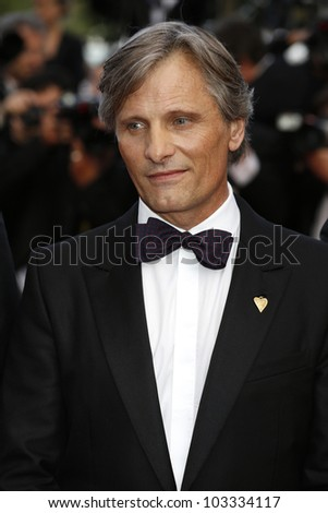 CANNES - MAY 23: Viggo Mortensen at the premiere screening of 'On the Road' presented in competition at the 65th Cannes film festival on May 23, 2012 in Cannes - stock photo