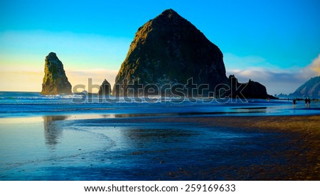 Cannon Beach Sunset.  Oregon Coast USA.  Travel and Vacation Photograph. - stock photo