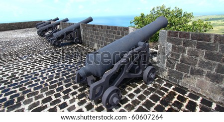 Cannons line the walls at Brimstone Hill Fortress National Park on Saint Kitts - stock photo