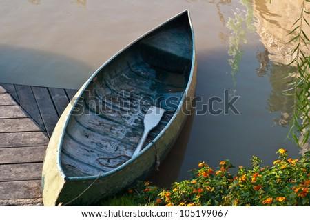 Canoe in the river - stock photo