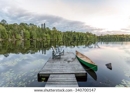 Canoe Tied to a Dock - Haliburton, Ontario, Canada - stock photo