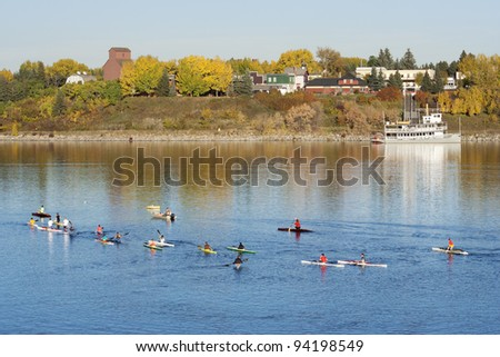 Canoeing at Glenmore Reservoir, Heritage Park in the background, Calgary, Alberta, Canada - stock photo