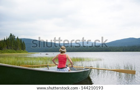 Canoeing on Lake Noel in Jacques Cartier National Park, Canada - stock photo