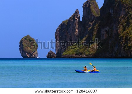 canoeing on Phi Phi island Thailand - stock photo