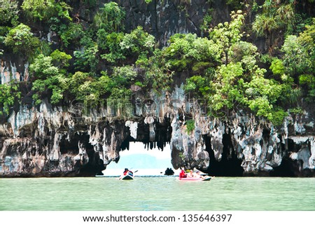 canoeing through the cave - stock photo