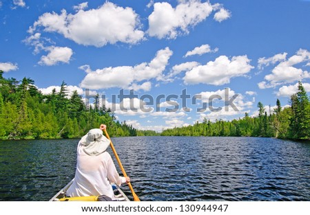 Canoer on Horsehoe Lake in the Boundary Waters - stock photo