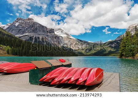 Canoes on an open lake in the canadian rockies - stock photo