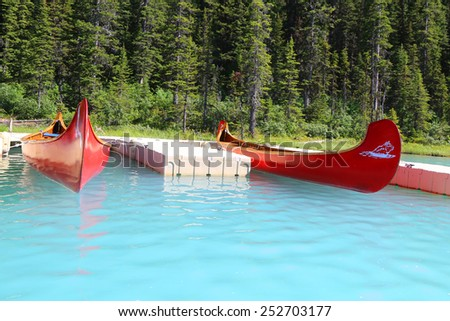 Canoes on beautiful turquoise lake  - stock photo