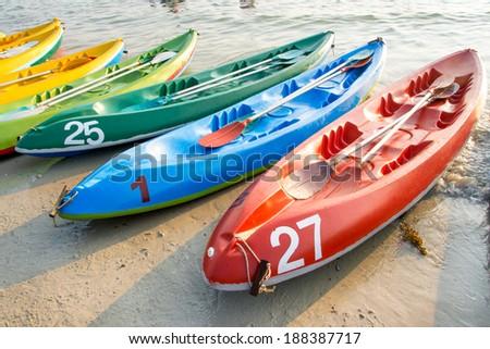 Canoes on the beach - stock photo