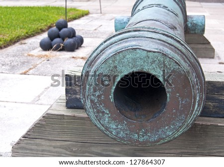 Canon and cannonballs, in a fort, overcast day. Castillo de San Marcos, St. Augustine, Florida. 16th century. - stock photo