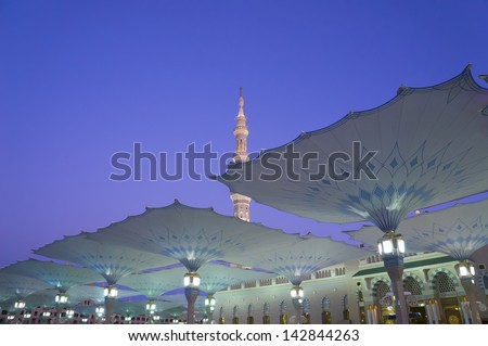Canopies of Masjid Al Nabawi (Mosque of the Prophet) at sunrise in Medina (City of Lights), Saudi Arabia.Nabawi mosque is Islam's second holiest mosque after Haram Mosque (in Mecca, Saudi Arabia) - stock photo