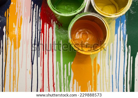 cans and colors drop on the wall for the background - stock photo