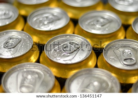 Cans with water drops macro shot - stock photo