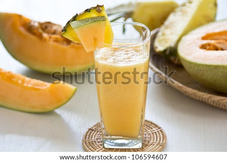 Cantaloup and Pineapple smoothie - stock photo