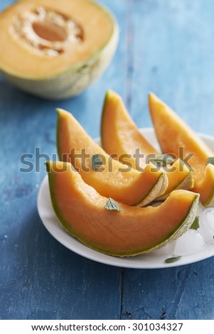 Cantaloupe melon with mint and ice - stock photo