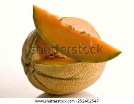 Cantaloupe with slice - stock photo