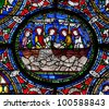 CANTERBURY, UK - APRIL 11: Detail of one of the Becket Miracle Windows in Canterbury Cathedral on 11 April 2012.  These windows were created 1180 -1220 and mark the shrine to St Thomas Becket. - stock photo