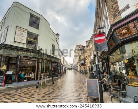 CANTERBURY, UK - JAN 13, 2015 Guildhall Street, Canterbury built in 1806 is pedestrianized and this crossroad, where four streets merge, is a pleasant place to site and enjoy coffee and refreshments. - stock photo