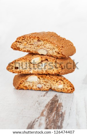 Cantuccini stack on white wooden textured background. Traditional italian culinary sweet dessert. - stock photo