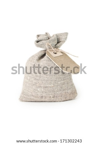 Canvas bag with cardboard tag on white background - stock photo