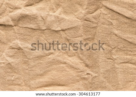 Canvas brown creases texture background - stock photo