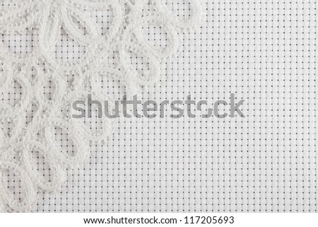 canvas for the embroidery a cross framed by a lace tape - stock photo