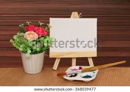 canvas frame and watercolor with wooden floor background - stock photo