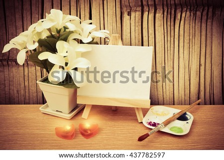 canvas frame ,water color and flower vase with old bamboo wall background - stock photo