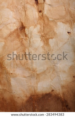canvas paper scrunched,worn and weathered for vintage antique effect - stock photo