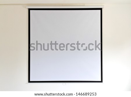 Canvas screen projectors on the walls of the room with a yellow background. - stock photo