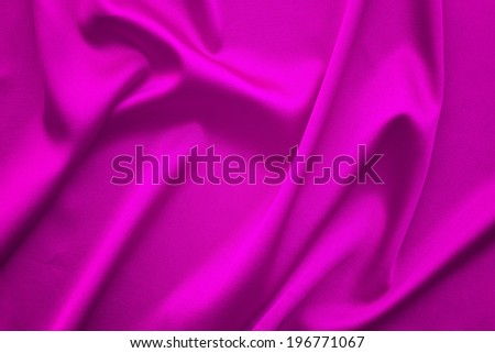 Canvas texture or background. Purple flowing satin tablecloth view from top. Empty tablecloth for product montage. Free space for your text  - stock photo