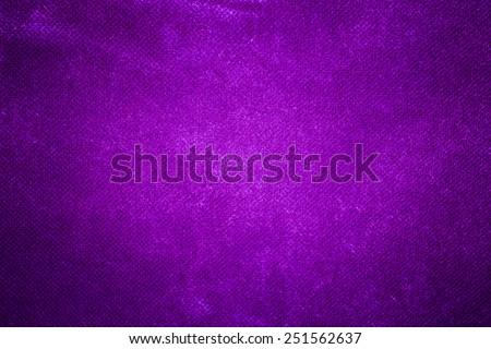 Canvas textured purple background. - stock photo
