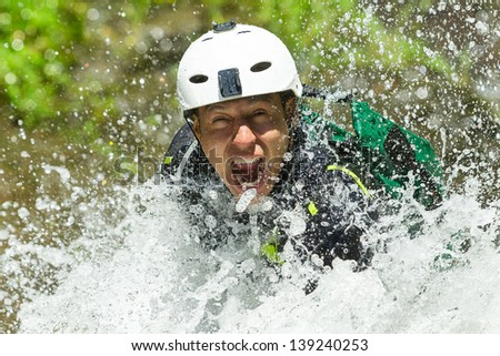 Canyoning guide trying out a new route in Chama waterfall, Banos De Agua Santa, Ecuador - stock photo