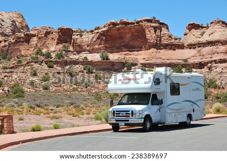 CANYONLANDS, UNITED STATES - JUNE 22, 2013: RV truck parked in Canyonlands National Park, USA. More than 452,000 people visited Canyonlands NP in 2012. - stock photo