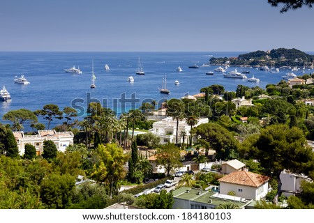 CAP FERRAT, FRANCE - MAY 28, 2012: Private Houses along the coast of Cap Ferrat, offers one of the most beautiful tourist destinations and one of the most expensive residential location in the world - stock photo