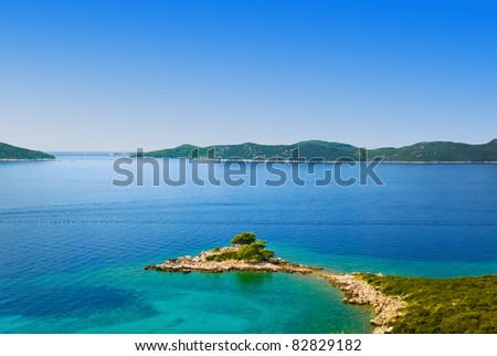 Cape and islands in Croatia - nature vacations background - stock photo