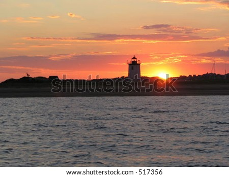 Cape Cod lighthouse at sunset - stock photo