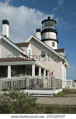 Cape Cod lighthouse offers tours during the summertime to the tower and the adjoining museum which was once the keeper'??s building. - stock photo