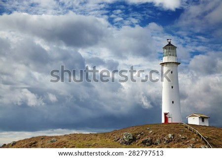 Cape Egmont Lighthouse, Taranaki coast, New Zealand - stock photo