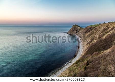 Cape in the sea - stock photo