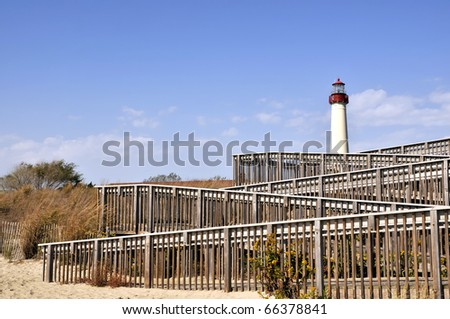 Cape May Lighthouse With Beach Steps Foreground Horizontal With Copy Space - stock photo