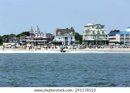 Cape May, NJ, June 24, 2015: Beach goers enjoy a beautiful day in Cape May, New Jersey. - stock photo