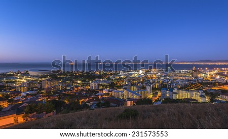 Cape Town's urban city scape during sunset over the stadium, harbor and V&A waterfront. - stock photo