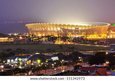 CAPE TOWN, SOUTH AFRICA - APRIL 7: Cape Town Greenpoint Stadium at night on April 7, 2012 in Cape Town, South Africa. This place was used as a 2010 FIFA World Cup kick off in Cape Town, South Africa. - stock photo