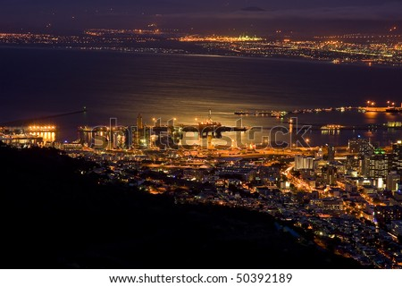 Cape Town, South Africa at night, with the city  lit up by all the lights - stock photo