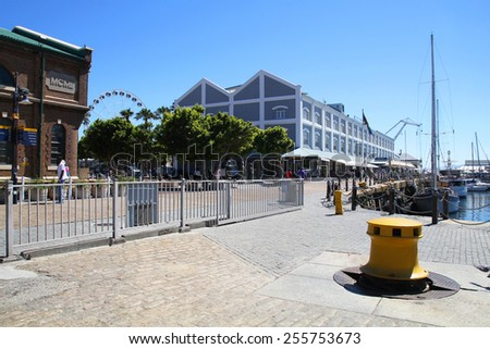 CAPE TOWN, SOUTH AFRICA- DECEMBER 25: The Victoria and Alfred Waterfront (V&A) surrounding the city's harbour in Cape Town, South Africa on December 25, 2013. - stock photo