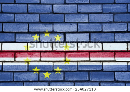 Cape Verde flag painted on old brick wall texture background - stock photo